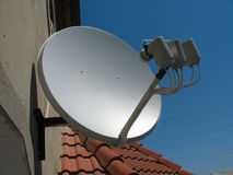 Satellite dish antenna over blue sky Royalty Free Stock Image