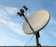 Satellite dish antenna over blue sky background Royalty Free Stock Images