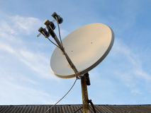 Satellite dish antenna over blue sky background Royalty Free Stock Photos