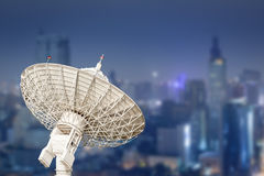 Satellite dish antenna radar and building background Stock Photography