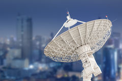Satellite dish antenna radar and building background Stock Images