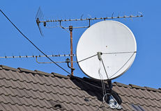 Satellite dish and antenna on the roof Royalty Free Stock Photos