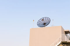Satellite dish antenna on rooftop Royalty Free Stock Image