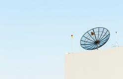 Satellite dish antenna on rooftop Stock Photo