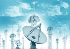 Satellite dish antenna. With telecommunication towers on blue sky royalty free stock photography