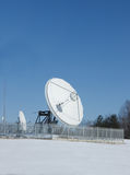 Satellite dish antennas in snows Royalty Free Stock Images