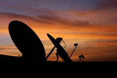 Satellite dish antenna at sunset Stock Photos