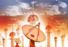 Satellite dish antenna. With telecommunication towers on blue sky stock image