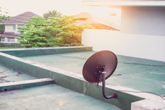 Satellite dish antenna on top of the building and the sun. Satellite dish antenna on top of the building and the sun royalty free stock images