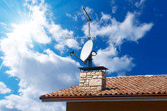 Satellite Dish and Antenna TV on Blue Sky Royalty Free Stock Photos