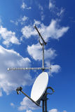 Satellite Dish and Antenna TV on Blue Sky Royalty Free Stock Image