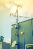 Satellite Dish and Antenna TV .  ( Filtered image processed vint Royalty Free Stock Photos