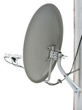 Satellite dish antenna on wall Stock Image