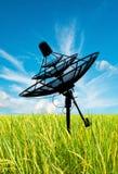 Satellite dish antennas in field Stock Photos