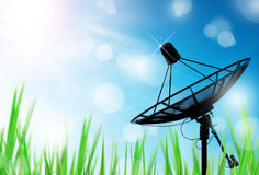 Satellite dish antennas in field under sky Stock Photos