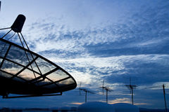 Satellite dish and antennas with morning sky Stock Photos
