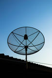 Satellite dish antennas on the roof Stock Images