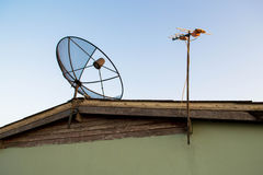 Satellite dish antennas on the roof Royalty Free Stock Image