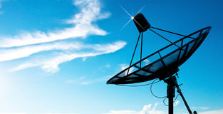 Satellite dish antennas under blue sky Royalty Free Stock Photo