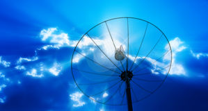 Satellite dish antennas under blur sky Stock Image