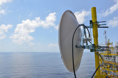Satellite dish antennas under sky, Communication equipment in offshore oil and gas industry Royalty Free Stock Photos
