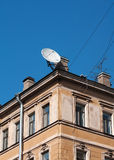 Satellite dish on background of an old  house Royalty Free Stock Image