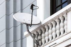 Satellite dish on the balcony Royalty Free Stock Photo