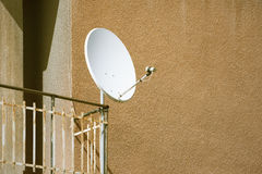 Satellite dish at a balcony Stock Images