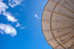 Satellite dish with blue sky. Satellite dish point to the satellite through the sky Royalty Free Stock Images