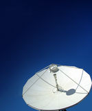 Satellite dish on blue sky Royalty Free Stock Image