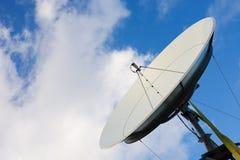 Satellite dish on blue sky stock images