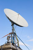 Satellite dish on a blue sky Royalty Free Stock Photos
