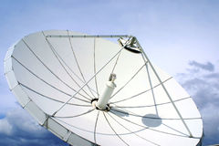 Satellite-dish on blue sky. White satellite-dish and dramatic blue sky Stock Photo