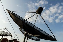 Satellite dish. In the blue sky Royalty Free Stock Photos