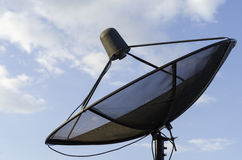 Satellite dish. On blue sky background Stock Photos