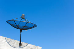 Satellite dish on blue sky background Stock Images