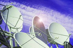 Satellite dish on blue sky background Stock Images