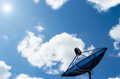Satellite dish on blue sky. Black antenna communication satellite dish on blue sky royalty free stock photo