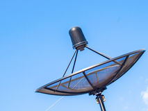 Satellite dish in blue sky Royalty Free Stock Image