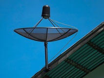 Satellite dish blue sky. On roof Royalty Free Stock Photos
