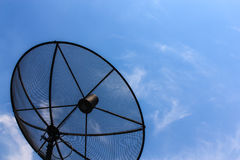 Satellite dish with blue sky. In the sunrise day Royalty Free Stock Image