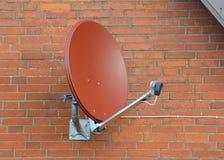 Satellite dish on a brick wall Stock Photography