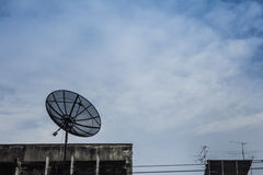 Satellite dish on building rooftop Royalty Free Stock Photos