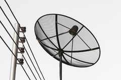 Satellite dish and cable communication technology network royalty free stock image
