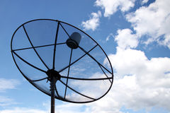 Satellite dish and Clouds on Blue sky. Royalty Free Stock Image