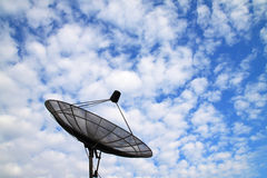 Satellite dish with clouds and sky Stock Images