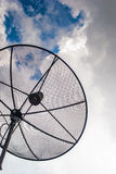 Satellite dish in cloudy day. Taken in rural area Stock Photo