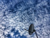 Satellite dish. On cloudy sky royalty free stock photo