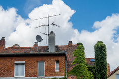 Satellite dish contra old antenna Stock Images