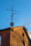 Satellite dish contra old antenna Stock Image